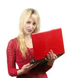 Person and personal computer. The young beautiful woman in  red blouse  with the red laptop Stock Image