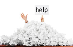 Person in pile of papers royalty free stock photography