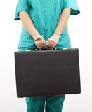Person pinned to suitcase with handcuffs hand Royalty Free Stock Images
