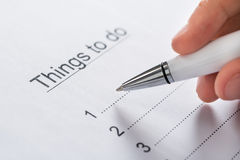 Person Planning List Of Work om te doen Stock Foto