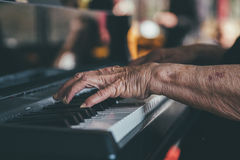 Person Playing Black Upright Piano Stock Photos