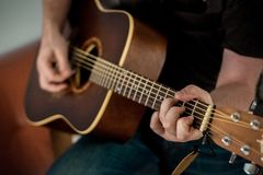 Person Playing Brown Guitar stock photo