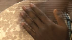 Person playing a drum stock footage