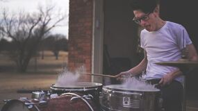 Person Playing on Drums during Daytime Stock Photo