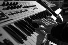 Person Playing Electric Piano in Grayscale Photo Stock Image