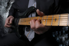 Person playing gitar close up down neck Royalty Free Stock Images