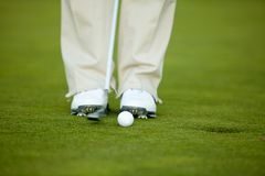 Person playing golf Stock Image