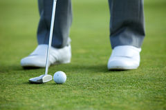 Person playing golf, low section Stock Image