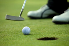 Person playing golf, low section Royalty Free Stock Image