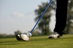 Person playing golf, low section Stock Images