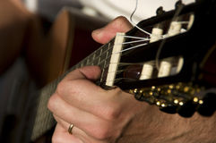 Person playing guitar. Details of person playing acoustic guitar Stock Photos