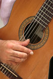 Person playing guitar. Hand of person playing acoustic guitar Royalty Free Stock Photography