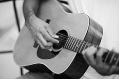 Person playing a guitar Royalty Free Stock Photo