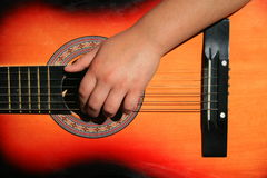 Person Playing Guitar. Close up of a person playing guitar Stock Photo