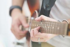 Person playing the Guitar Stock Photos