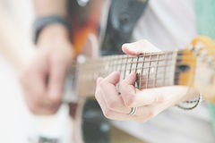 Person playing the Guitar Royalty Free Stock Photo