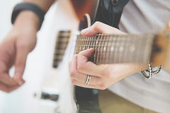 Person playing the Guitar Royalty Free Stock Images