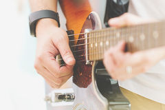 Person playing the Guitar Stock Images