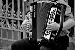 Person Playing a Horner Musical Intrument in Grayscale Stock Photos