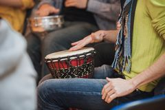 Person playing on Jambe Drum no face Royalty Free Stock Photos