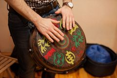 Person playing on Jambe Drum no face Royalty Free Stock Photography