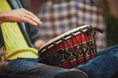 Person playing on Jambe Drum no face Stock Images