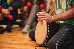 Person playing on Jambe Drum no face Royalty Free Stock Images
