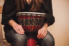 Person playing on Jambe Drum no face Stock Photo