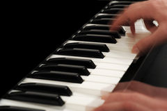 Person playing piano. Hands of person playing notes on black piano with copy space Royalty Free Stock Images