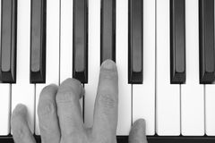 Person playing on a piano Royalty Free Stock Images