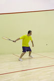 Person playing squash Stock Images