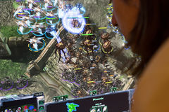 Person playing Starcraft II 2 pc game at gaming convention Royalty Free Stock Photo