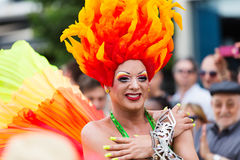Person in plumage at Gay pride parade in Sitges Royalty Free Stock Images