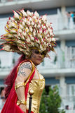 Person in plumage at Gay pride parade in Sitges Stock Image