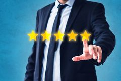 Person pointing on 5 star review, costumer feedback concept - five stars rating royalty free stock photos