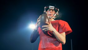 Posing footballer on a field, close up. American football player stock video footage
