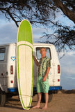 Person Posing with Surfboard Stock Images