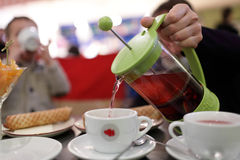 Person pouring fruit tea Royalty Free Stock Photos