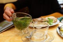 Person pouring mint tea Royalty Free Stock Photos