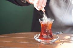person pouring sugar into tea Royalty Free Stock Photos