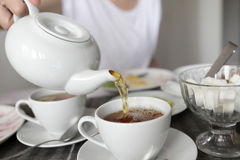 Person pouring tea Stock Photography