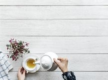 Person Pouring Tea on a Cup royalty free stock photography