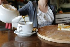 Person pouring tea Royalty Free Stock Photography
