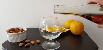 Person pours brandy into a glass stock images