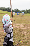 Person practicing at outdoor archery target range royalty free stock photos