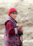 A person with prayer wheel going to attend Dalai Lama speech royalty free stock photos