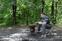 Person preparing barbecue Royalty Free Stock Images