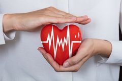 Person Protecting Heart Images libres de droits