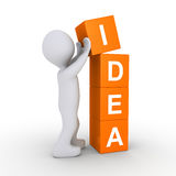 Person providing idea. 3d person is putting the last cube of the word IDEA Stock Photos