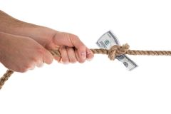 Person pulling banknote tied in a rope Royalty Free Stock Images
